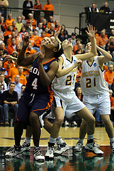 19 March 2010: Philana Greene and Caroline Bernal-Silva work against each other for rebound position. The Flying Dutch of Hope College defeat the Yellowjackets of the University of Rochester in the semi-final round of the Division 3 Women's Basketball Championship by a score of 86-75 at the Shirk Center at Illinois Wesleyan in Bloomington Illinois.