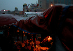 An ethnic Uighur woman tends her stall in the Dabazha or Grand Bazaar area in Urumqi city, Xinjiang Uighur Autonomous Province, China, 16 November 2017. Uighurs, a Muslim ethnic minority group in China, make up about 40 per cent of the 21.8 million people in Xinjiang, a vast, ethnically divided region that borders Pakistan, Afghanistan, Kazakhstan, Kyrgyzstan and Mongolia. Other ethnic minorities living in here include the Han Chinese, Kyrgyz, Mongolian and Tajiks people. Xinjiang has long been subjected to separatists unrests and violent terrorist attacks blamed by authorities on Islamist extremism while human rights groups say Chinese repression on religious rights, culture and freedom of movement caused undue tensions. Life however goes on under the watchful eye of the government for the ethnic Uighurs living in the city of Urumqi and surrounding areas and the region is still considered an attractive tourist spot. A recent report by state media Xinhua news agency claims Xinjiang received more than 100 million tourists in 2017, 'the highest figure in its history'.