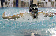 Cedar Rapids Jefferson's Kelsey Drake powers her way through the water in the 100 yard butterfly event at the Girls' High School State Swimming & Diving Championships at the Marshalltown YMCA/YWCA in Marshalltown on Saturday, November 9, 2013. Drake placed second with a time of 55.48.