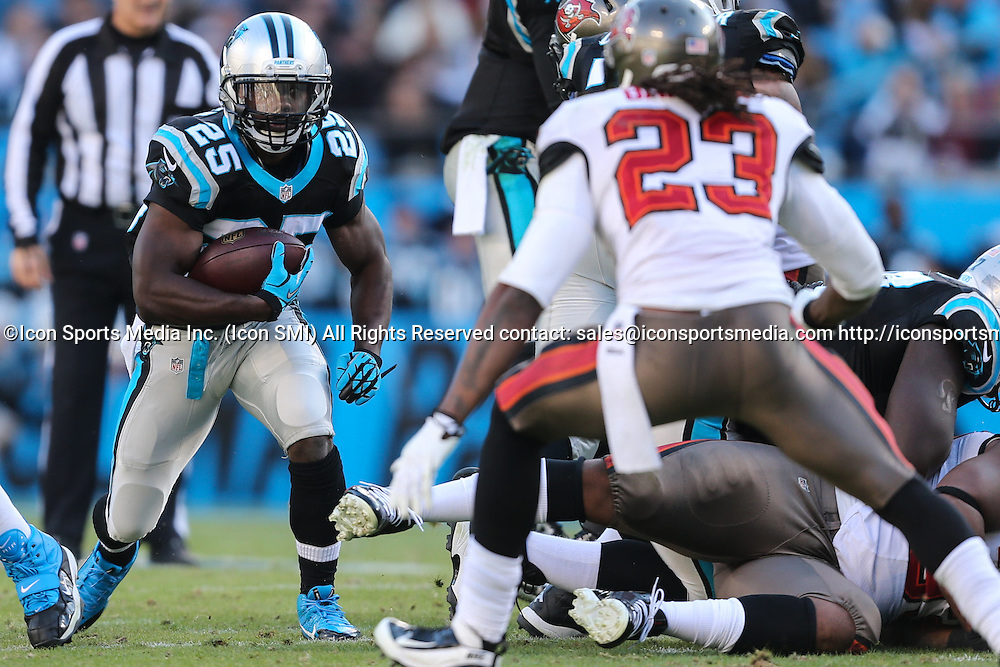 December 1, 2013: Carolina Panthers running back Kenjon Barner (25) looks for room past Tampa Bay Buccaneers strong safety Mark Barron (23) during game action at Bank of America Stadium in Charlotte, NC. The Panthers win 27-6 over the Buccaneers.
