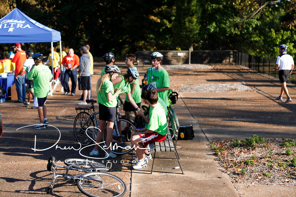 9-OCT-2010 -- ST LOUIS - Riders pause at the Jefferson Barracks in Saturday's inaugural Pedal the Cause bicycle ride.  Over 700 people participated and the ride raised in excess a reported $1million for cancer research in St. Louis..Pedal the Cause was founded as an annual cycling event that seeks to provide and direct net funding for cancer research, cancer discovery grants and clinical translational care on best ideas not currently eligible for federal funds.  With 100% of donations remaining in St. Louis, the event was started by Bill Koman, a St Louis business man and himself a cancer survivor.