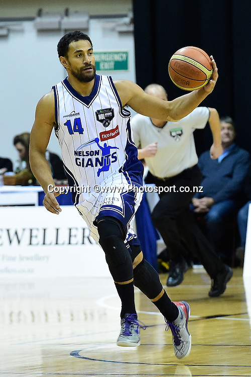 Mika Vukona of the Giants looks to pass during a NBL - Saints vs Giants semi final four basketball match at the TSB Arena in Wellington on Friday the 4th of July 2014. Photo by Marty Melville/www.Photosport.co.nz