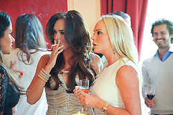TAMARA ECCLESTONE smoking at a party to celebrate Tamara Ecclestone's 28th birthday held in Tyringham, Newport Pagnell, Bucks on15th June 2012.