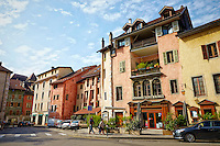 A view of Le Brasserie Saint-Maurice, and other historic, colorful Neo-Classic Facade buildings, Old Annecy, France.