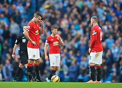 MANCHESTER, ENGLAND - Sunday, November 2, 2014: Manchester United's Robin van Persie looks dejected as Manchester City score the opening goal during the Premier League match at the City of Manchester Stadium. (Pic by David Rawcliffe/Propaganda)