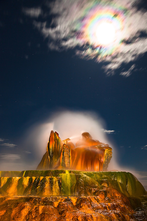 """Full Moon Over Fly Geyser 1"" - Photograph of the famous Fly Geyser in Nevada with a rainbow like corona around a full moon."