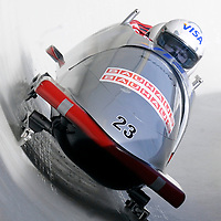01 March 2009:     The Canada 2 bobsled driven by Lyndon Rush with sidepushers Robert Sean Thomas Gray and Chris Le Bihan, and brakeman Lascelles Brown drives through turn 19 in the 3rd run at the 4-Man World Championships competition on March 1 at the Olympic Sports Complex in Lake Placid, NY.   The USA 1 bobsled driven by Steven Holcomb with sidepushers Justin Olsen and Steve Mesler, and brakeman Curtis Tomasevicz won the competition and the World Championship bringing the U.S. their first world championship since 1959 with a time of 3:36.61.