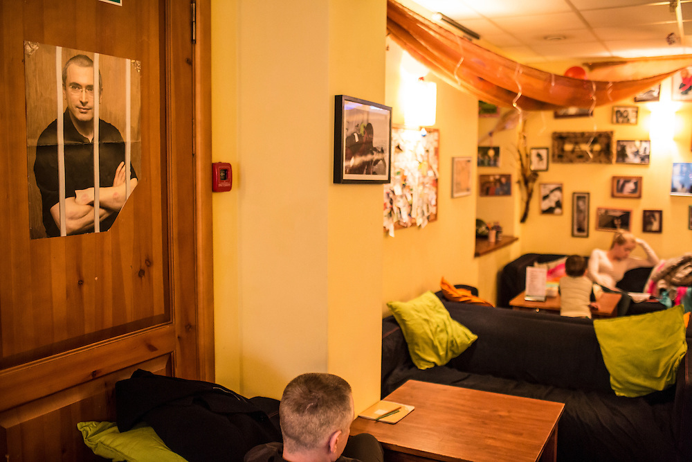 A poster of Mikhail Khodorkovsky, who was jailed for a number of years as a political opponent of President Vladimir Putin until his recent release under an amnesty, hangs inside the Coffeetown Cafe, a favorite hangout of Alexander Panin, on Tuesday, February 25, 2014 in Tver, Russia. Panin, a Tver native, was arrested in the Dominican Republic in June 2013, and is set to be charged by federal authorities in the US with being part of a gang which robbed bank accounts via the Internet. Photo by Brendan Hoffman, Freelance