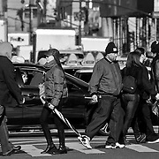 In the crosswalk on a typically busy afternoon in midtown, Manhattan, NYC
