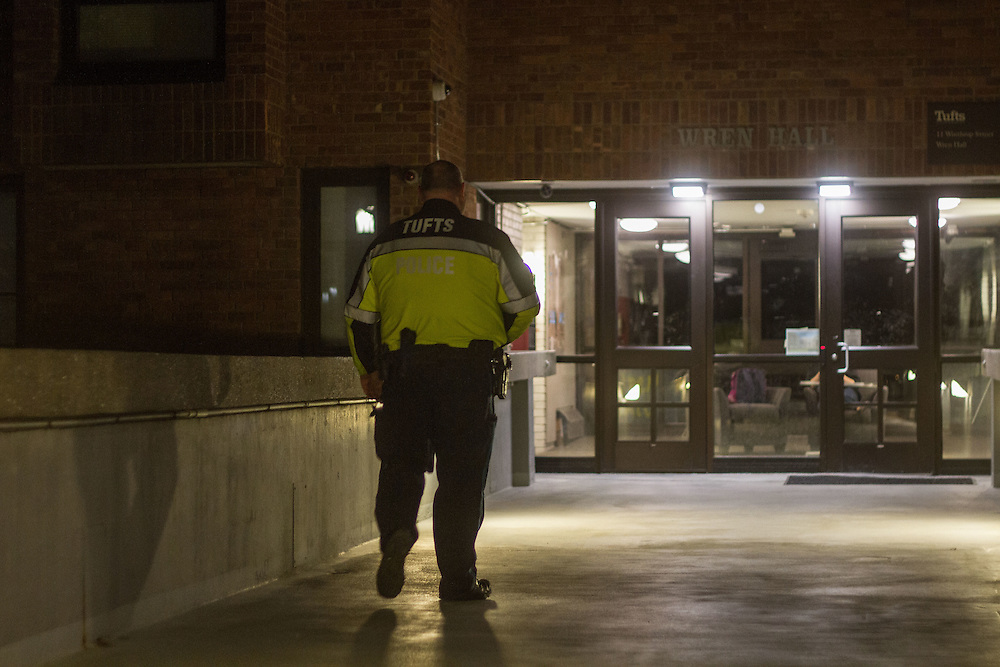 4/14/16—Medford/Somerville—A TUPD officer patrols Wren Hall on the night of April 14, 2016, following an assault incident that occurred in the dorm earlier this month. (Max Lalanne/The Tufts Daily)