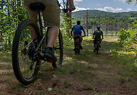 Pat O'Brien , Charles DeCoff and Jeremy Lambert on an EBike tour around Cobble Mountain at Gunstock Tuesday morning.  (Karen Bobotas/for the Laconia Daily Sun)