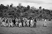 "Supporters of the two dogs, who are going to fight, walk around the arena designed for the battle, to motivate the participant at one of the first event of the season. Countryside of Islamabad. Pakistan, on sunday, December 14 2008.....According to the Islamic tradition, angels do not enter a house which contains dogs. Even if they are considered ""ritually unclean"" by the jurists, the fighting dogs of Pakistan are tolerated by institutions and by believers alike. These mastiffs are grown and trained explicitly for these matches. Spectators in this area flock-in from nearby villages whenever a famous dog is scheduled to enter the arena. And this is more than just a show: entire families base their social esteem on the results of such bloody confrontations."