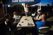 Jim Hyde with Rayhyde Adventures hangs from the BMW Motorcycles awning while talking to customers and employees.