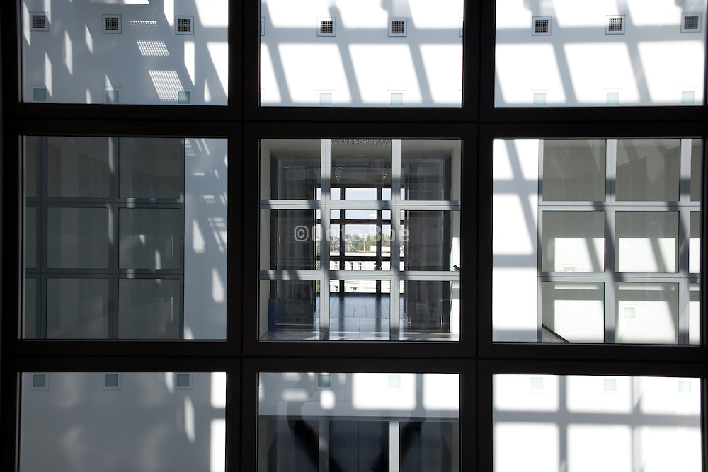 view through a window to the other side of the building