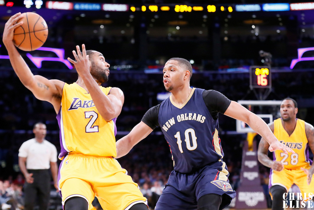 01 April 2015: Los Angeles Lakers guard Wayne Ellington (2) tries to pass the ball to Los Angeles Lakers forward Tarik Black (28) over New Orleans Pelicans guard Eric Gordon (10) during the New Orleans Pelicans 113-92 victory over the Los Angeles Lakers , at the Staples Center, Los Angeles, California, USA.