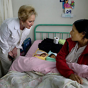 Congresswoman Kay Granger visits Isabel, the mother of newborn twins, at Ayacucho regional hospital. ..The Ayacucho Regional Hospital is the largest government hospital in the region - serving approximately 580,000 people. The hospital is committed to respecting the practices of the indigenous community within the region by supporting their traditional birthing practices. Doing so encourages more indigenous women to give birth in the hospital while maintaining their cultural practices, but in a safer environment thereby reducing maternal mortality. Vertical birthing, for example, is common for the Qechua community. Women believe that their feet should be planted on the ground when they are giving birth and their partners need to be involved in the process by typically standing behind them and pushing on the women's belly while she delivers the baby.