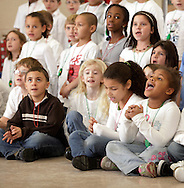Second graders from Pakanasink Elementary School in Circleville sing holiday songs for seniors at the Wallkill Community Center in the Town of Wallkill on Thursday, Dec. 10, 2009.