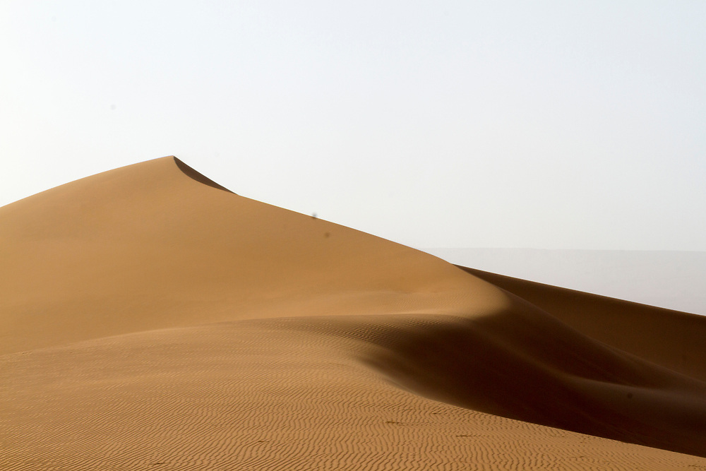 M'HAMID EL GHIZLANE, MOROCCO - 28th April 2014 - Sahara Desert landscape beyond M'Hamid el Ghizlane, Erg Chigaga region of the fringes of the Sahara Desert in Southern Morocco