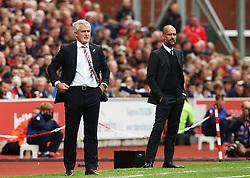 Stoke City manager Mark Hughes and Manchester City manager Pep Guardiola  - Mandatory by-line: Matt McNulty/JMP - 20/08/2016 - FOOTBALL - Bet365 Stadium - Stoke-on-Trent, England - Stoke City v Manchester City - Premier League