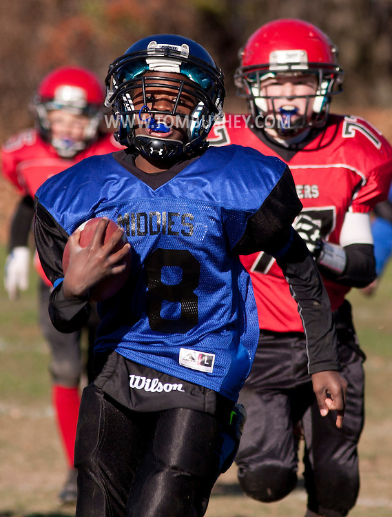 Middletown, New York - A Middletown player runs with the football against Port Jervis in an Orange County Youth Football League Division II semifinal playoff game at Watts Park on  Nov. 15, 2014.
