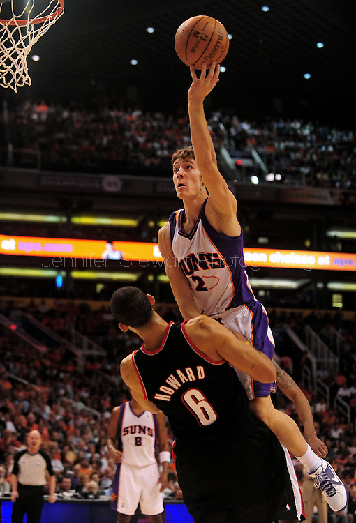 Apr 26, 2010; Phoenix, AZ, USA; Phoenix Suns guard Goran Dragic (2) drives the ball against Portland Trailblazers forward Juwan Howard (6) during the second quarter in game five in the first round of the 2010 NBA playoffs at the US Airways Arena.  Mandatory Credit: Jennifer Stewart-US PRESSWIRE