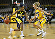 26 JANUARY 2009: Michigan guard Veronica Hicks (3) tries to drive inside while being defended by Iowa guard Kristi Smith (11) during the second half of an NCAA women's college basketball game Monday, Jan. 26, 2009, at Carver-Hawkeye Arena in Iowa City, Iowa. Iowa defeated Michigan 77-69.