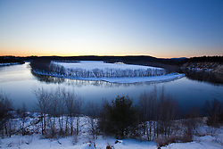 Just after sunset as seen from a bluff overlooking the Merrimack River in Canterbury, New Hampshire. Winter. Oxbow.
