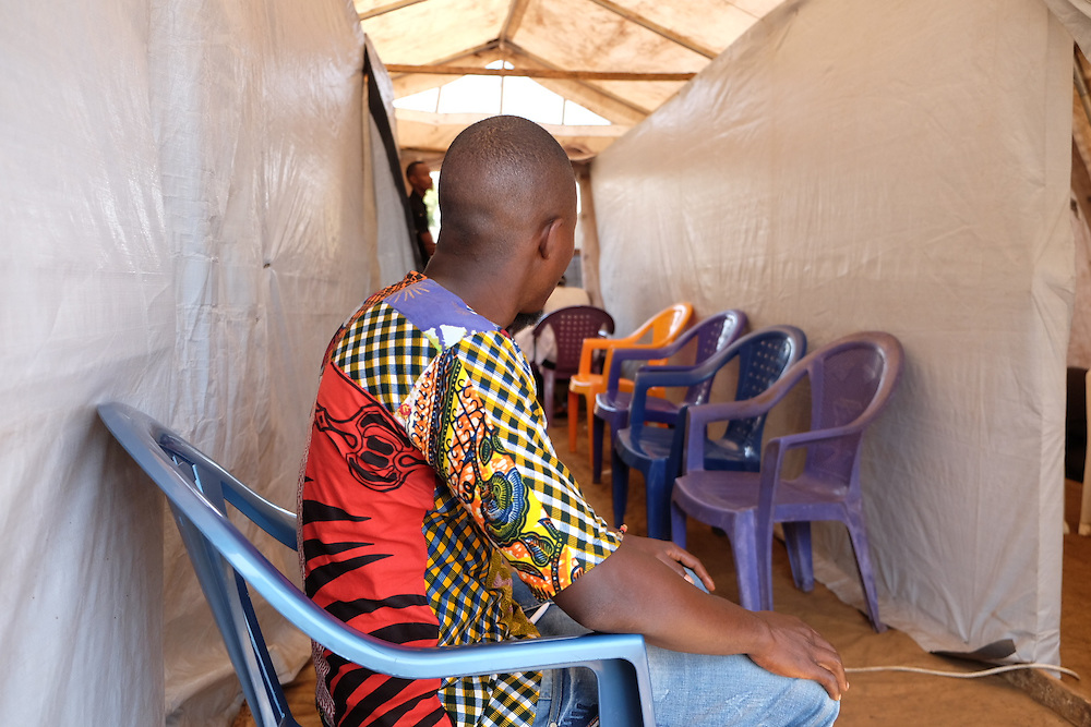 Mohamed Camara waits for testing inside the MSF mobile clinic in the neighbourhood of Sangoyah Market, Conakry, Guinea on March 17, 2016. MSF launched a HIV testing campaign in Conakry with the support of health authorities moving throughout several neighbourhoods throughout 2016.<br /> <br /> Despite countries in West and Central Africa having a relatively low HIV prevalence (