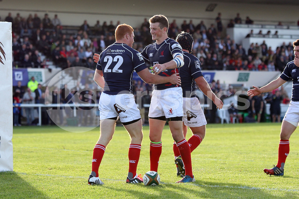 Connor Braid scores the first of his two tries and is congratulated by teammate Peter Lydon during the Green King IPA Championship match between London Scottish &amp; Plymouth Albion at Richmond, Greater London on Sunday 5th October 2014<br /> <br /> Photo: Ken Sparks | UK Sports Pics Ltd<br /> London Scottish v Plymouth Albion, Green King IPA Championship,5th October 2014<br /> <br /> &copy; UK Sports Pics Ltd. FA Accredited. Football League Licence No:  FL14/15/P5700.Football Conference Licence No: PCONF 051/14 Tel +44(0)7968 045353. email ken@uksportspics.co.uk, 7 Leslie Park Road, East Croydon, Surrey CR0 6TN. Credit UK Sports Pics Ltd
