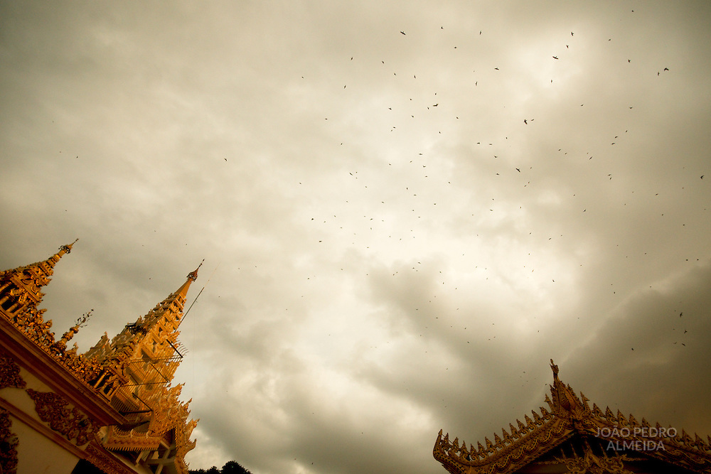 Birds fying over Mahamuni temple in Mandalay