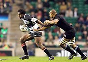 2004_'The Gartmore Challenge' - Barbarians_vs_New-Zealand..Australian Lotu Tuqiri is tracked by Mose Tuiali'i..04.12.2004 Photo  Peter Spurrier. .email images@intersport-images.com...