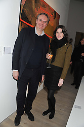 WILLIAM CASH and LADY LAURA CATHCART at a private view of Fly to Baku - Contemporary Art from Azerbaijan held at Phillips de Pury, Howick Place, London SW1 on 17th January 2012.