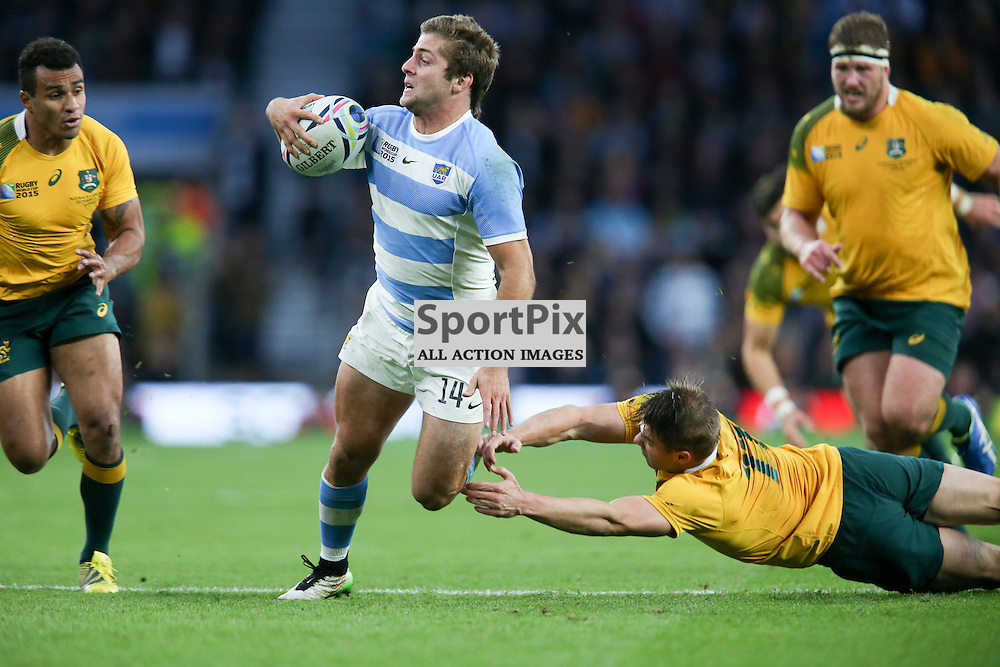 TWICKENHAM, ENGLAND - OCTOBER 25: Santiago Cordero of Argentina get passed Drew Mitchell of Australia during the 2015 Rugby World Cup semi-final two match between Argentina and Australia at Twickenham Stadium, London on October 25, 2015 in London, England. (Credit: SAM TODD | SportPix.org.uk)