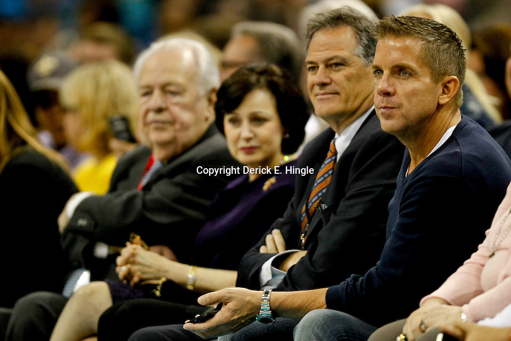 Feb 6, 2013; New Orleans, LA, USA; New Orleans Saints head coach Sean Payton watches courtside with general manager Mickey Loomis and New Orleans Hornets and Saints owner Tom Benson and Gayle Benson during the second quarter of a game against the Phoenix Suns at the New Orleans Arena. Mandatory Credit: Derick E. Hingle-USA TODAY Sports
