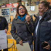 WASHINGTON,DC - MAR18: Lashae Hunter, a senior at Cesar Chavez Public Charter School for Public Policy, celebrates with her mother Warrenrenia Hunter, after she was surprised at school with a hand-delivered acceptance letter and full scholarship from George Washington Universtiy President Steven Knapp, March 18, 2015, through the Stephen Joel Trachtenberg Scholarship program. (Photo by Evelyn Hockstein/For The Washington Post)