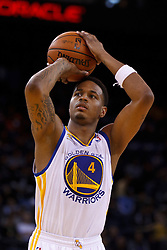 Mar 16, 2012; Oakland, CA, USA; Golden State Warriors shooting guard Brandon Rush (4) shoots a free throw against the Milwaukee Bucks during the fourth quarter at Oracle Arena. Milwaukee defeated Golden State 120-98. Mandatory Credit: Jason O. Watson-US PRESSWIRE