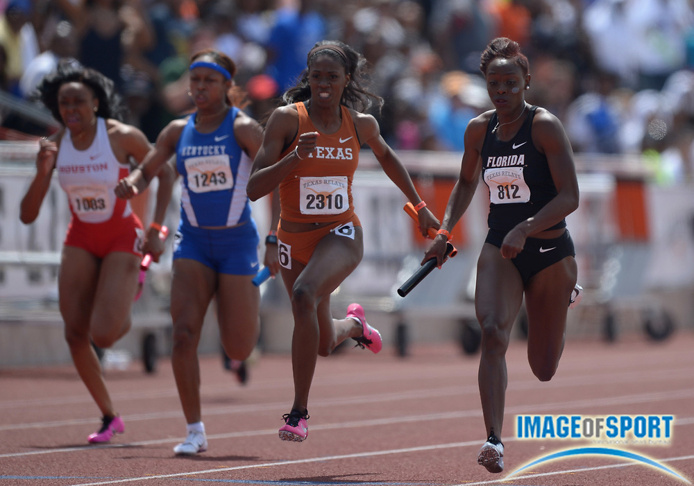 Mar 29, 2014; Austin, TX, USA; Ebony Eutsey of Florida (right) outleans Ashley Spencer of Texas on the anchor of the womens 4 x 100m relay, 43.60 to 43.64, in the 87th Clyde Littlefield Texas Relays at Mike A. Myers Stadium.