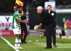 Yeovil Town's Wesley McDonald and Aston Villa's manager Steve Bruce during the Carabao Cup, First Round match at Huish Park, Yeovil.