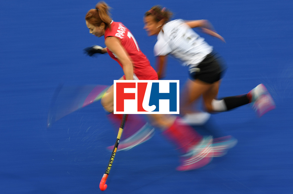South Korea's Park Seunga and Germany's Selin Oruz chase the ball during the women's field hockey Germany vs South Korea match of the Rio 2016 Olympics Games at the Olympic Hockey Centre in Rio de Janeiro on August, 10 2016. / AFP / MANAN VATSYAYANA        (Photo credit should read MANAN VATSYAYANA/AFP/Getty Images)