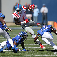Lauren Wood | Buy at photos.djournal.com<br /> Ole Miss wide receiver Laquon Treadwell evades Memphis defensive back Chauncey Lanier during Saturday's game at Memphis.