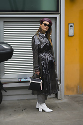 January 15, 2018 - Milan, Italy - A guest wearing sheer rain coat, bag, white boots is seen outside Armani during Milan Men's Fashion Week Fall/Winter 2018/19 on January 15, 2018 in Milan, Italy. (Credit Image: © Nataliya Petrova/NurPhoto via ZUMA Press)