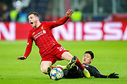 Red Bull Salzburg forward Hwang Hee-chan (9) brings down Liverpool defender Andrew Robertson (26) during the Champions League match between FC Red Bull Salzburg and Liverpool at the Red Bull Arena, Salzburg, Austria on 10 December 2019.
