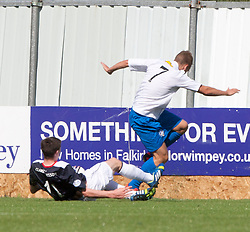 Morton's Joseph McKee injured in this tackle by Falkirk's Conor McGrandles.<br /> half time : Falkirk 2 v 0 Morton, Scottish Championship 17/8/2013.<br /> &copy;Michael Schofield.