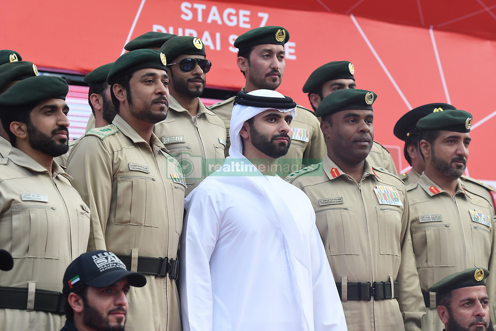 March 2, 2019 - Dubai, United Arab Emirates - Sheikh Mansour Bin Mohammed Bin Rashid Al Maktoum posses for a photo with members of the Police during the Awards Ceremony, after he wins the inagural edition of the UAE Tour. .On Saturday, March 2, 2019, in Dubai City Walk, Dubai Emirate, United Arab Emirates. (Credit Image: © Artur Widak/NurPhoto via ZUMA Press)