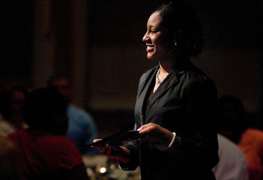 Cherrelle Turner walks back to her seat with her award during the Division of Student Affairs' 24th annual Leadership Recognition reception on Wednesday, 5/23/07, at the Baker Center.