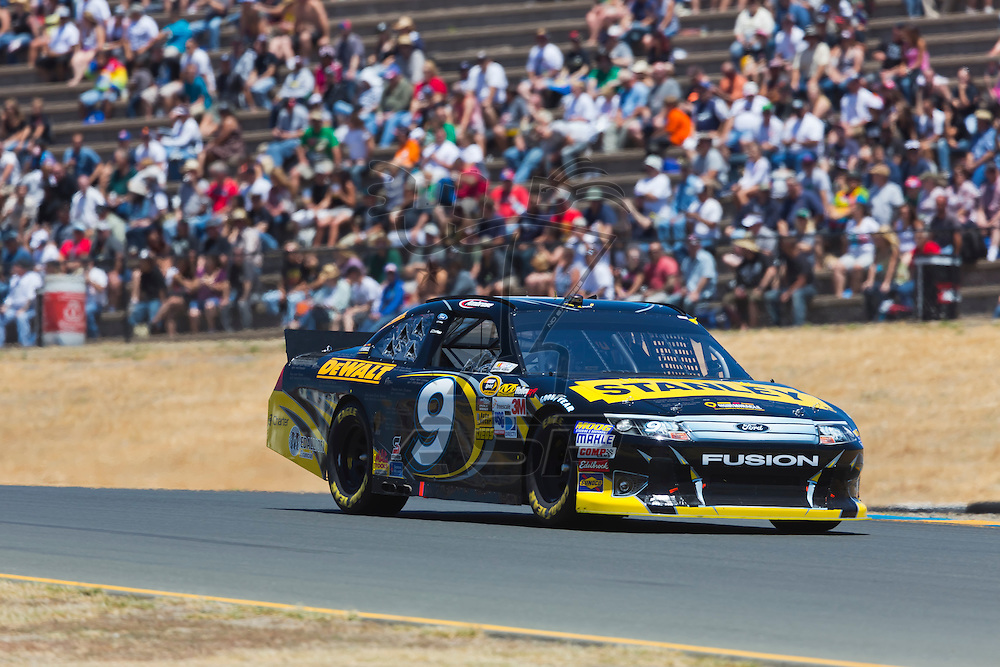 SONOMA, CA - JUN 24, 2012:  Marcos Ambrose (9) brings his car through the turns during the Toyota Save Mart 350 at the Raceway at Sonoma in Sonoma, CA.