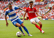 Tjaronn Chery shields the ball from Morgan Fox during the Sky Bet Championship match between Charlton Athletic and Queens Park Rangers at The Valley, London, England on 8 August 2015. Photo by Andy Walter.