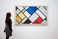 Woman looking at painting Countercomposition XVI by Theo van Doesburg at Gemeentemuseum in The Hague, Den Haag,  Netherlands