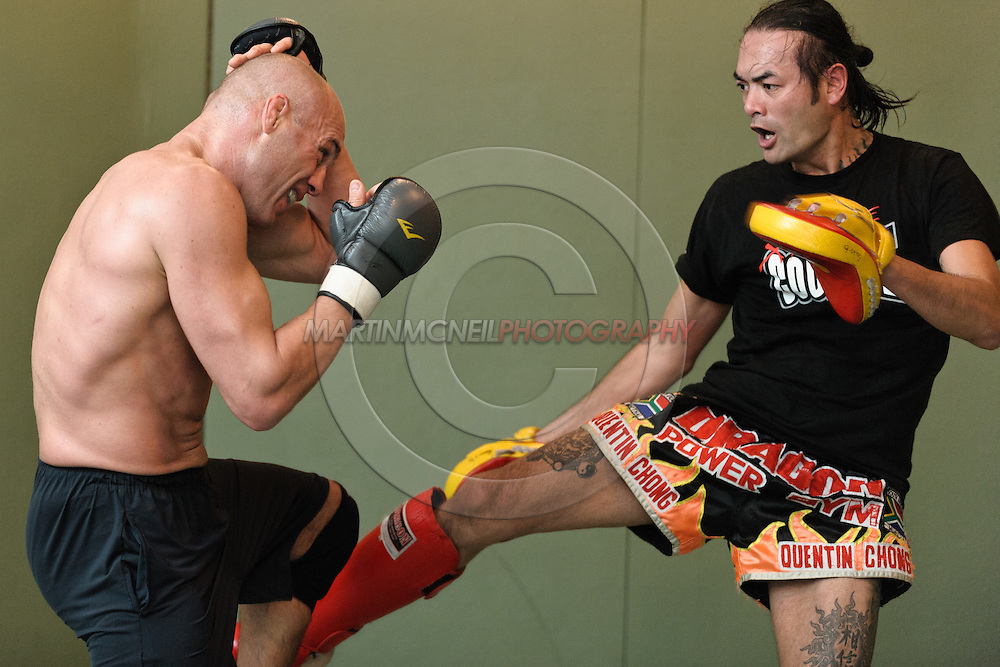 Randy Couture (left) and Quentin Chong work on muay thai striking defence during a pre-fight training session at Straight Blast Gym ahead of UFC 105 in Manchester, England on November 12, 2009.
