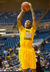 West Virginia Mountaineers guard Breana McDonald (20) shoots against the TCU Horned Frogs at the WVU Coliseum.